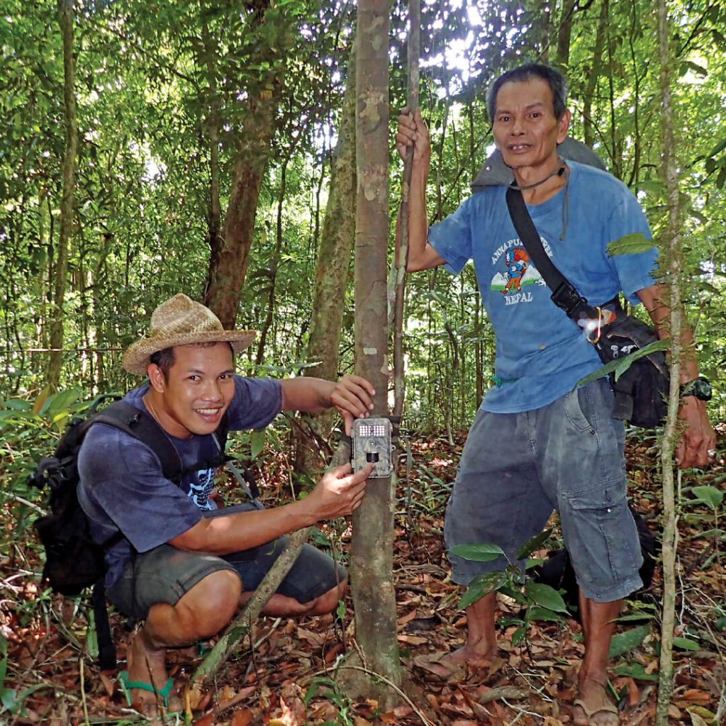 Rangers with camera trap on Negros island, Philippines